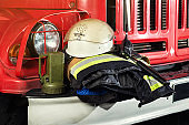 Firemen gear on firetruck such as fire barrel, special clothing, ration, helmet and lamp