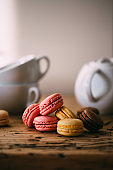 Colorful macaroons on old rustic wooden table
