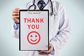 Doctor holding a clipboard with Thank you, Medical concept