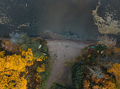 Aerial view to autumn lake and forest
