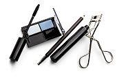 Cosmetics: Eyeshadow Palette, Eyeliner, Mascara and Eyelash Curler Isolated on White Background