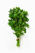 A bunch of parsley isolated on white background. Green fresh, ecological parsley bound by a  eco rope.