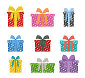 Set of holiday gift boxes with bow knots. Collection of packaged presents.