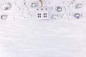 sweet home. christmas decorations on white natural wooden background