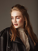 Portrait of young beautiful woman wearing leather jacket