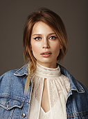 Portrait of beautiful and stylish woman wearing denim jacket