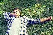 Lazily resting on the backyard lawn.