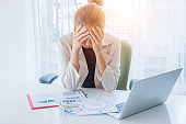 seriously asian woman in office business concept, Business woman who is tired, business woman is stressed from work , business concept.