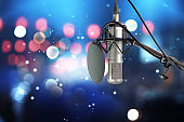 Condencer microphone with pop filter on stage .
