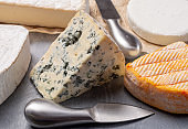 French cheeses plate in assortment, blue cheese, brie, munster, soft goat cheese, Neufchatel