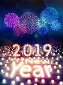 Happy New Year 2019 with Light Bulbs and Fireworks