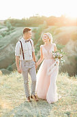 wedding couple on the nature in summer day.