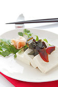 tofu and preserved egg on white background