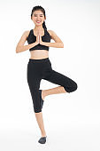 Sporty young asian woman doing yoga practice isolated on white background - concept  healthy life  fitness for slim.
