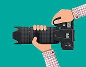 Modern photo camera in hand.