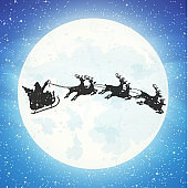 Santa claus on sleigh full of gifts and reindeers