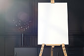 Easel and blank white canvas with christmas decoration. 3d rendering.
