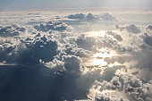 Flying above the clouds during sunrise