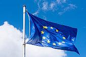 EU Flag waving against blue Sky