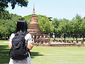 backpacker looking to ruin pagoda at old temple