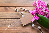 Happy International Women Day, hyacinth over wooden background