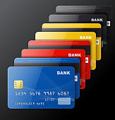 Set of credit cards isolated on black background.