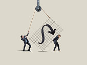 Businessman And Businesswoman Lifting Large Chart With Rope And Hoist