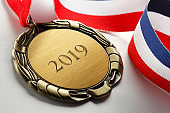 Gold Medal Engraved With 2019 On White Background