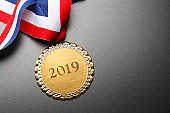 Gold Medal Engraved With 2019 On Black Background