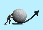 Businessman Attempting To Push Large Sphere Uphill