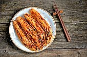 Organic kimchi with hot peppers and rice on an old wooden background. rustic style meal. Korean food.