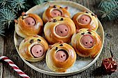 Cute pig buns with sausages - symbol of 2019, the idea for children's breakfast.