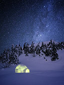 Amazing winter night scene with igloo snow and a starry sky