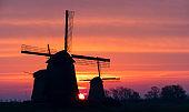 Sunrise behind Windmills