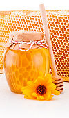 Fresh honey with honeycomb isolated on white background