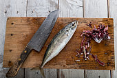 Prepared mackerel fish on wooden slate