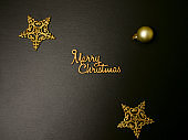 Merry Christmas decorations on black background. Handwriting. Flat lay holiday concept.