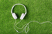 White headphones on a green grass