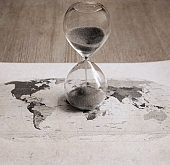 Sandglass, political map of the world, time passing
