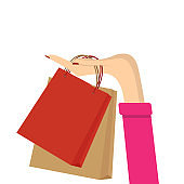 A hand holding shopping bags. Vector illustration
