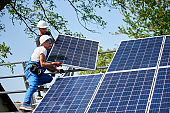Stand-alone exterior solar panel system installation, renewable green energy generation concept.