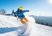Shot of a professional skier riding the slope on a beautiful winter day