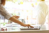 businesswoman working with laptop on workplace.