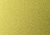 Golden glitter texture background. Metallic paper for design.