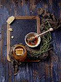 Thyme honey with comb on chalk board
