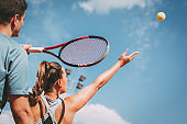 Girl Practice Tennis With Coach