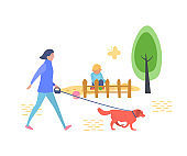 Young girl is walking in children's recreation park with dog.