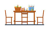 Set products and vegetables, in wicker basket. Wooden furniture