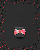 Gift Box with bow on black background