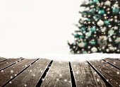 Christmas tree defocused and wooden plank